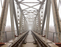 Railroad goes into the mist. gray misty autumn morning. Royalty Free Stock Images