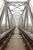 Railroad goes into the mist. gray misty autumn morning. Royalty Free Stock Photos
