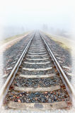Railroad goes into the mist. gray misty autumn morning. Stock Photo