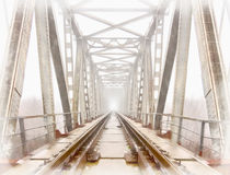 Railroad goes into the mist. gray misty autumn morning. Royalty Free Stock Photography