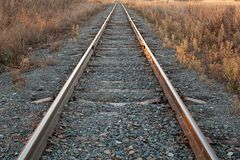 Railroad goes to horizon in sunset stock photos