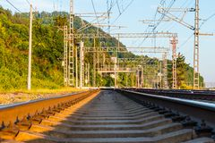 Railroad going into distance in sunny day Royalty Free Stock Photo