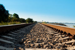 Railroad going to the distance near the shore Royalty Free Stock Photo