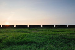 Railroad grain cars in the prairies with blue sky Stock Photo