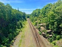 Railroad in Halifax forest, New Brunswick, Canada. Railroad in Halifax green forest, New Brunswick, Canada Stock Photography