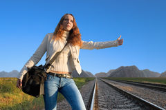 Railroad hitch hiking-3. Girl waiting for a new train Stock Images