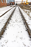 Railroad in industrial area in winter Stock Photo