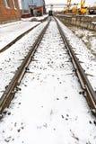 Railroad in industrial area in winter Stock Photo