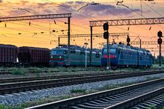 Railroad infrastructure during beautiful sunset and colorful sky, trains and wagons, transportation and industrial concept Royalty Free Stock Images