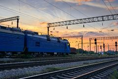 Railroad infrastructure during beautiful sunset and colorful sky, trains and wagons, transportation and industrial concept Royalty Free Stock Photos