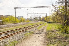 Railroad infrastructure - rails, semaphores, power lines stock photo