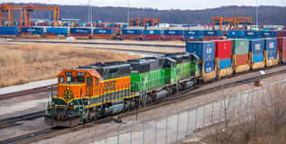 Freight Train. BNSF and Burlington Northern colored locomotives building a double stack train at an intermodal yard Stock Photos