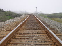 Railroad junction. Railroad tracks going forever into the fog royalty free stock photo