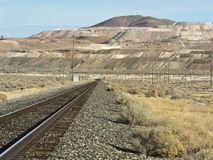 Railroad leads to the mine at Sulphur, Nevada. Railroad tracks approaching the huge mine at Sulphur, Nevada stock image