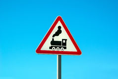 Railroad Level Crossing Sign. Without barrier or gate ahead the road, beware of train roadside steam engine locomotive signage road sign on signpost pole. Train royalty free stock photo