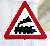 Railroad Level Crossing Sign without barrier or gate ahead the rod. With bridge concrete pillow stock image