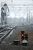 Railroad with a light signal. Railroad with a red light signal Royalty Free Stock Photo