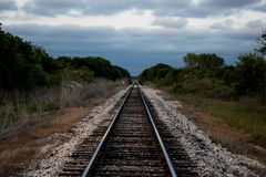 Railroad line into the storm royalty free stock images