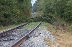 Railroad lines blocked by trees taken down by Hurricane Florence. Raeford, North Carolina, United States/August 17, 2018: Railroad tracks blocked by trees taken royalty free stock image