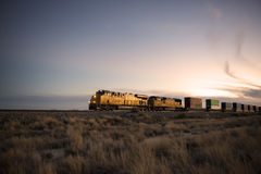 Railroad locomotive at dusk Stock Photos