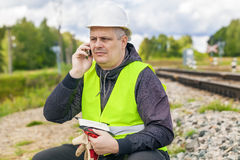 Railroad maintenance worker talking on the phone Royalty Free Stock Image