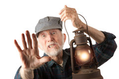 Railroad man holding lantern Stock Image