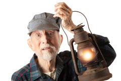 Railroad man holding lantern Royalty Free Stock Images