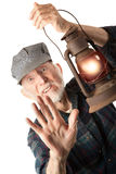 Railroad man holding lantern Stock Images