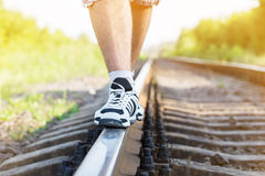 Railroad man legs. Sunny day Stock Image