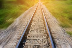Railroad in motion with sun rays background. Blurred railway. Transportation. Railroad in motion with sun rays background. Blurred railway Transportation stock photography