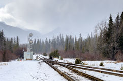 Railroad through the Mountains on a foggy Winter Day Royalty Free Stock Image