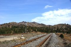 Railroad between mountains in Russia Stock Photo