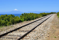 Railroad near lake Llanquihue, Chile. Railroad in front of volcaon Osorno and lake Llanquihue near Puerto Varas, Chile Stock Photography