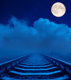Railroad in night with full moon Stock Photography