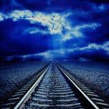 Railroad in night to horizon Stock Photography