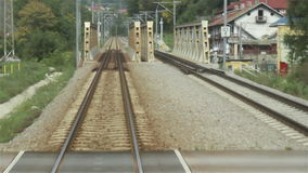 Railroad over Iron Bridge. View from moving train of railway and the embankment which crosses a steel poles bridge stock video