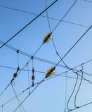 Railroad overhead lines against clear blue sky Stock Image