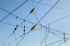 Railroad overhead lines against clear blue sky Stock Photos