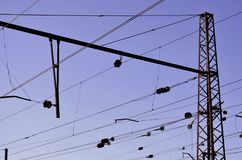 Railroad overhead lines against clear blue sky, Contact wire. High voltage railroad power lines on neutral blue sky backgroun. D royalty free stock image