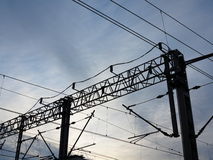 Railroad overhead lines. Contact wire. Stock Photo
