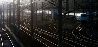 Railroad in panoramic view. Dark railroad and train in panoramic view Stock Photos
