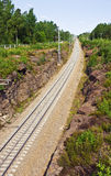Railroad passes through a rock in Vyborg Royalty Free Stock Photography