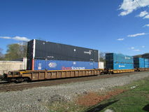 Railroad platform cars with Pacer Stacktrain, Umax and C.H. Robinson intermodal. Stock Photography