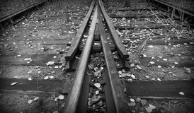 Railroad point. Closeup photo of rails in switch with arrow shape Royalty Free Stock Photos