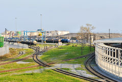 Railroad with railcars in the harbor of Genoa Stock Photo