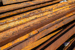 Railroad Rails rust. Old, used railroad rails piled up, waiting for disposal Stock Photos