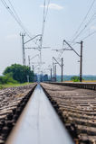 Railroad. Rails stretching into the distance on the bridge Stock Photography