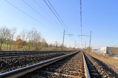 Railroad rails. Two sets of railroad tracks run straight and parallel Royalty Free Stock Image