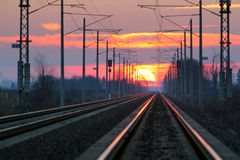 Railroad - Railway at sunset with sun Royalty Free Stock Photos