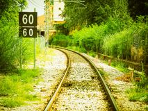 Railroad railway track vintage retro. Railway railroad tracks for train public transport and speed limit sign vintage retro royalty free stock photography
